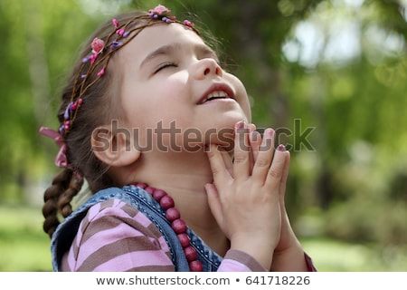christianity, child saying prayers outdoors Stock photo © godfer