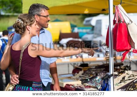 женщину человека глядя блошиный рынок Сток-фото © Kzenon