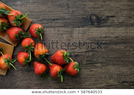 Strawberries  on cutting board on wooden table stock photo © Valeriy