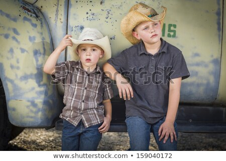 boy wearing cowboy hat outdoors stock photo © is2