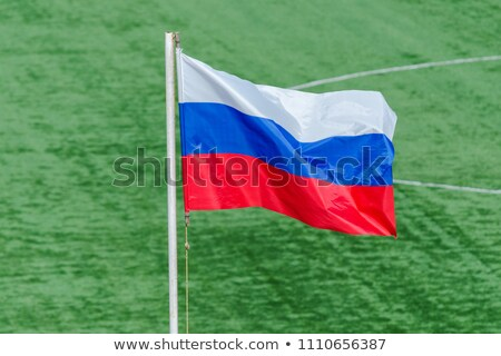 Football in russia colours against green background Stock photo © wavebreak_media