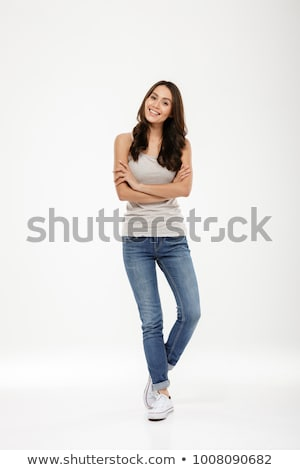 genç · kız · ayakta · silah · dışarı · gülen · kız - stok fotoğraf © monkey_business