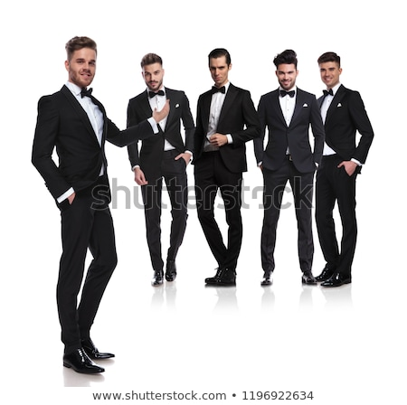 Knappe man zwarte smoking presenteert elegante groep Stockfoto © feedough