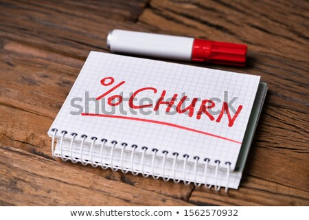 Stock photo: Notepad With Churn Percent Near Marker Over Desk