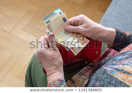 Idős nő Euro pénz bankjegyek megtakarított pénz Stock fotó © dolgachov