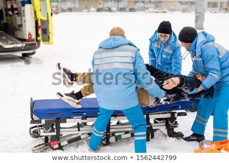 Invierno uniforme inconsciente hombre Foto stock © pressmaster