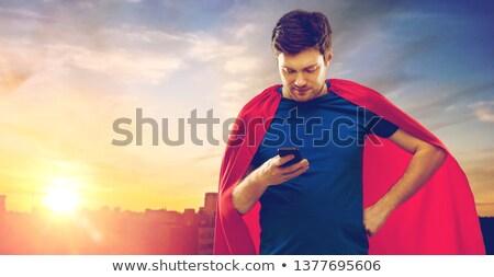 Adam süper kahraman şehir süper güç Stok fotoğraf © dolgachov