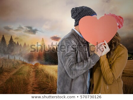 couple hiding behind tree stock photo © photography33