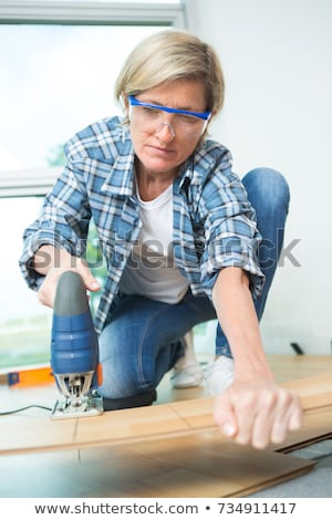 Man cutting floorboard stock photo © photography33