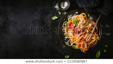 Spagetti domates sosu fesleğen yatay yemek İtalyan Stok fotoğraf © bugstomper