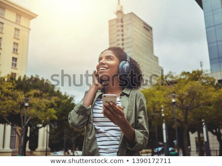 young woman smiling in front of a building Stock photo © photography33