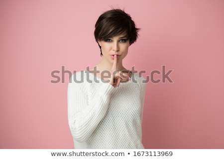 Beautiful woman expressing silence, finger on lips Stock photo © CandyboxPhoto