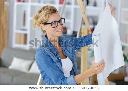 woman holding rolls of wallpaper stock photo © photography33