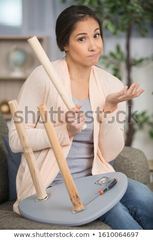 Woman with wrench struggling to hear Stock photo © photography33