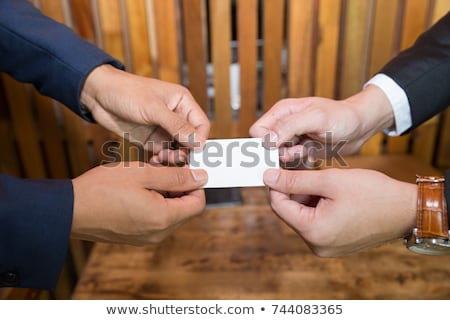 Businessman giving businesscard in a meeting Stock photo © photography33