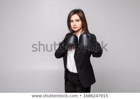 Ambitious businesswoman boxing  wearing a black suit  Stock photo © wavebreak_media