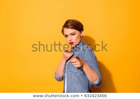 gülen · genç · kadın · işaret · yukarı · bakıyor · yalıtılmış - stok fotoğraf © pablocalvog