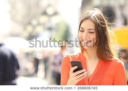 Ritratto donna d'affari cellulare felice bianco telefono Foto d'archivio © wavebreak_media