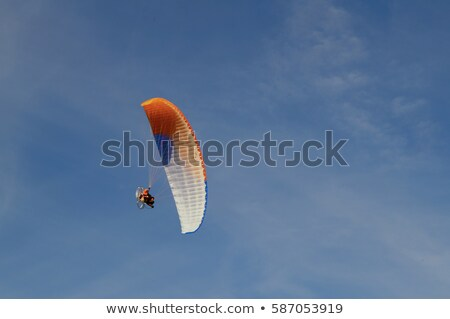 silhouette of paraglider and blue sky with clouds stock photo © bsani