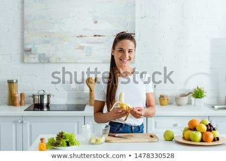 голодающий · сексуальная · женщина · еды · банан · девушки · улыбка - Сток-фото © kurhan