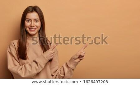 mooie · vrouw · wijzend · mooie · jonge · vrouw · permanente - stockfoto © stockyimages
