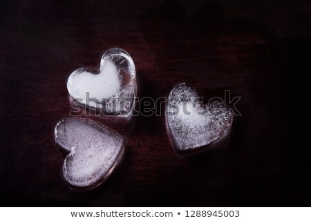 three melting ice cubes with water dew stock photo © karandaev