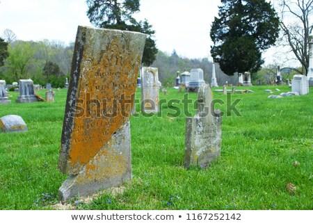 Zdjęcia stock: Very Old Broken Gravestone In The Cemetery