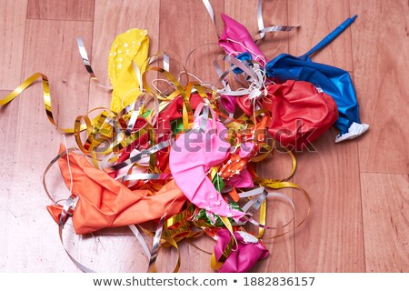 Colorful deflated balloons on the desk Stock photo © CaptureLight