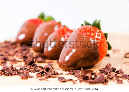 Chocolate dipped strawberries, chocolate pieces around him. Stock photo © justinb
