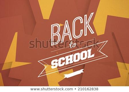 Brown paper strewn over orange Stock photo © wavebreak_media