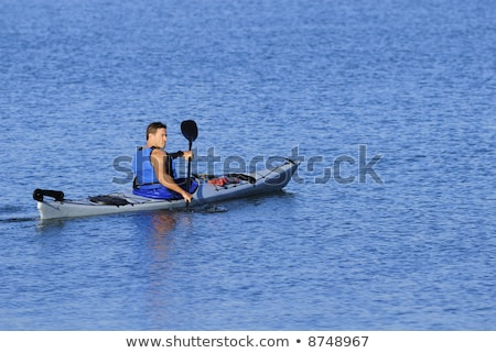Calm man looking back over his shoulder Stock photo © stockyimages
