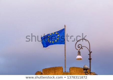 Flags of Italy, European Union and Roma city waving in Rome, Ita Stock photo © vladacanon