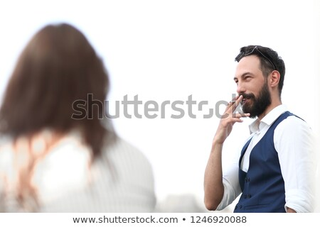 business man looking up while enjoying a cigarette stock photo © feedough