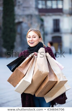 Blonde and many paper bags Stock photo © Paha_L