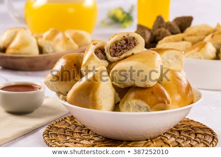 Deep fried stuffed pastry. Brazilian food pasteis on the table. Stock photo © paulovilela