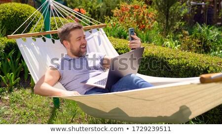 Hipster businessman answering the phone Stock photo © wavebreak_media