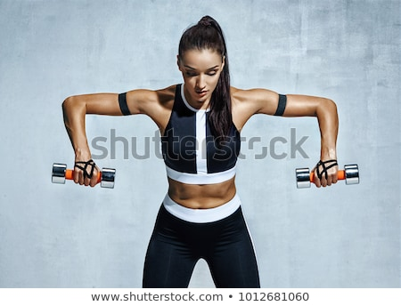sports woman with dumbbells isolated on a black background stock photo © nobilior