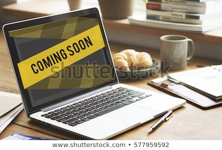 Under Construction on wooden table Stock photo © fuzzbones0