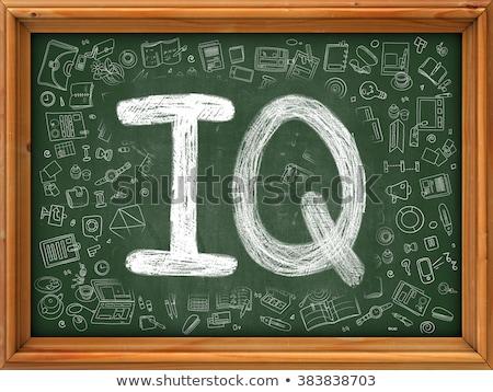 hand drawn intelligence test on green chalkboard stock photo © tashatuvango