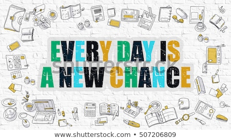 multicolor every day is a new chance on white brickwall stock photo © tashatuvango