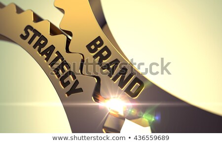 Brand Strategy on Golden Metallic Cog Gears. Stock photo © tashatuvango