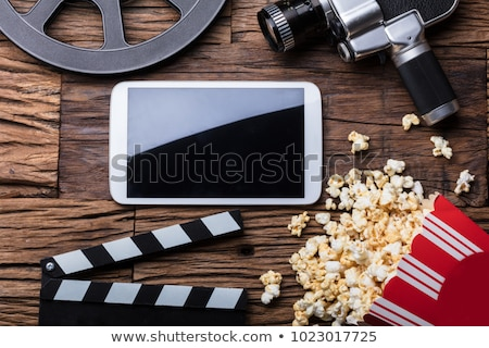 Elevated View Of Smartphone And Spilled Popcorn Stock photo © AndreyPopov