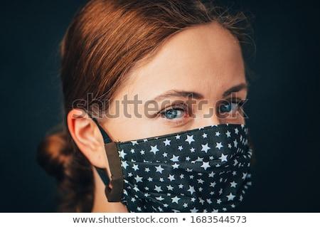 Girl wearing homemade mask Stock photo © IS2