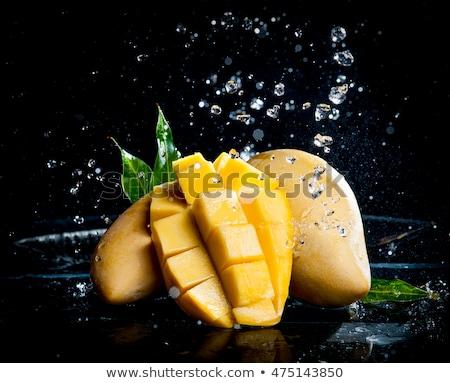 Mango vruchten zwarte geïsoleerd voedsel natuur Stockfoto © deandrobot