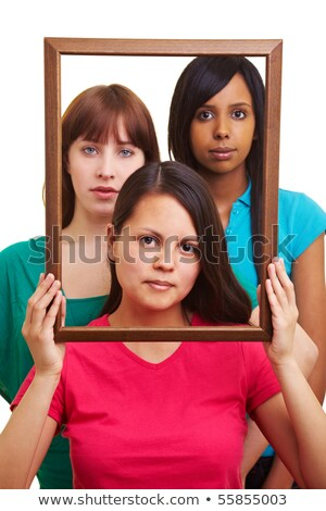 Image of three serious interracial women: caucasian, african ame Stock photo © deandrobot