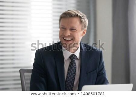 Uśmiechnięty w średnim wieku człowiek biznesu relaks posiedzenia Zdjęcia stock © deandrobot