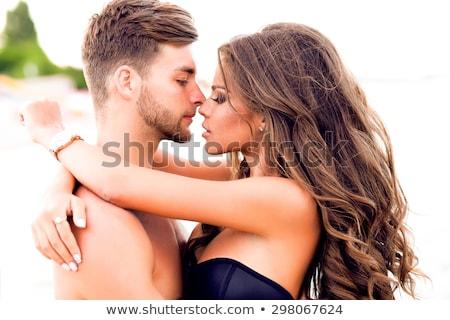 smiling couple running over tropical beach Stock photo © dolgachov