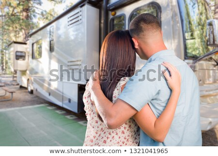 Young Military Couple Looking at New RV Stock photo © feverpitch