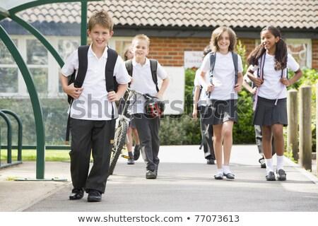 Ritratto scuola 10 anni ragazzo ragazza piedi Foto d'archivio © Lopolo