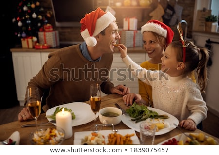 Christmas Family Dinner People Eating Food at Room Stock photo © robuart